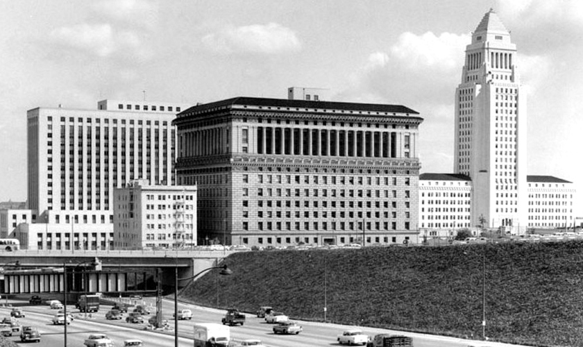 1957: Downtown Los Angeles skyline, looking out at the Hall of Justice building and City Hall
