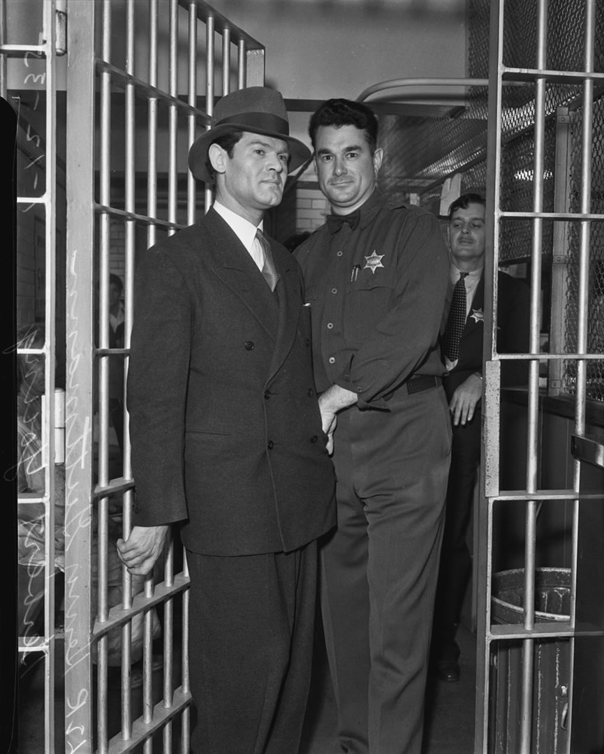 Henry Guttman convicted on theft charges being searched by Deputy Jailer Herbert Young, Los Angeles 1935