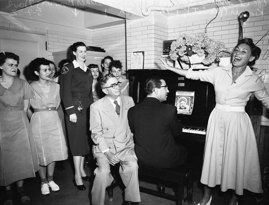Lieutenant Frances Blumfeld Sheriff Biscailuz and inmates on the 13th floor at HOJJ being entertained by singer Lillian Roth May 1952
